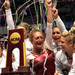 Oklahoma celebrates after being crowned co-champions with Florida during the NCAA college women's gymnastics championships on Saturday, April 19, 2014, in Birmingham, Ala. (AP Photo/Butch Dill)