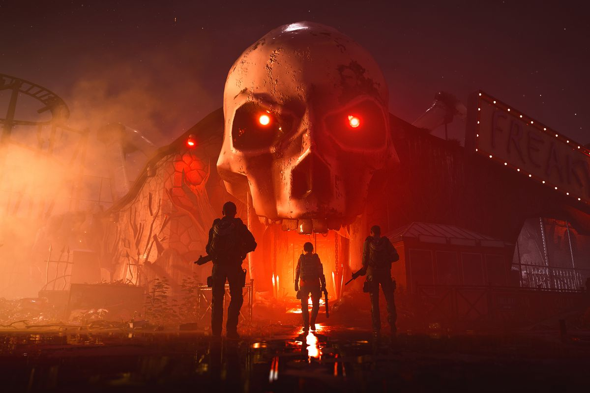 A team of three player characters stands in front of a menacing fun-house door shaped like a glowing skull.