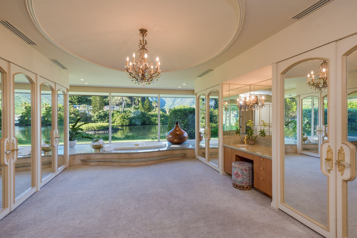 Opulent master bathroom with large windows.