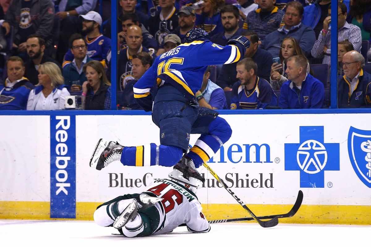 Ryan Reaves jumps up to smash an imaginary brick above his head, presumably to procure the fire flower within.