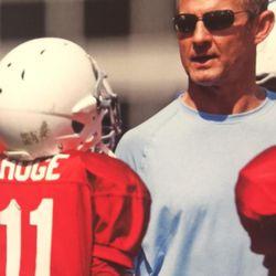 Merril Hoge coaching his son, Beau, in youth football.