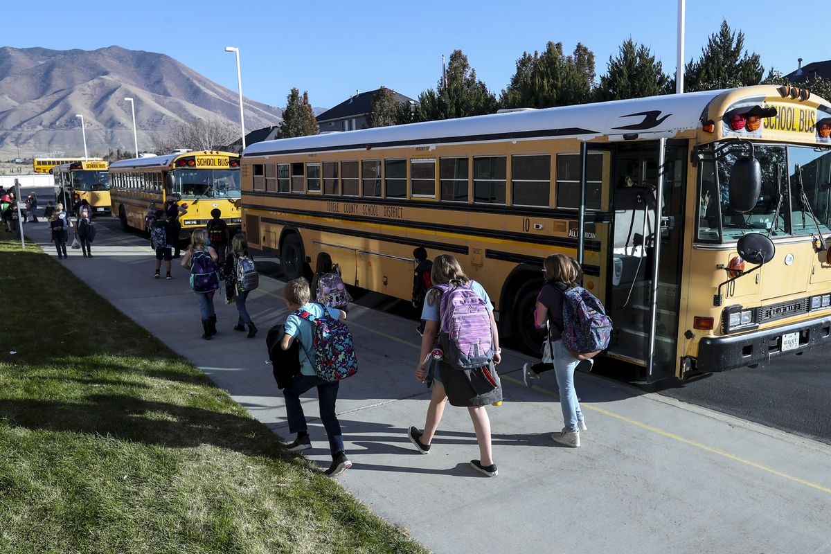 Students walk to their buses after school at Rose Springs Elementary in Erda, Tooele County, on Thursday, Nov. 5, 2020.