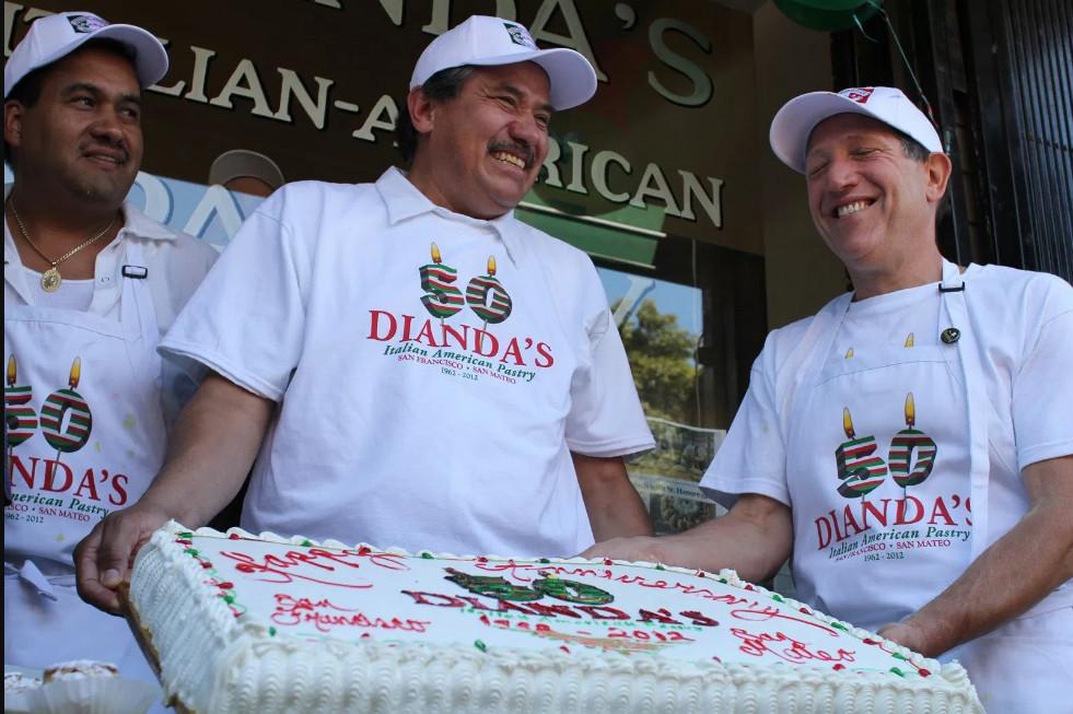 Chef's holding sheet cake at Dianda's