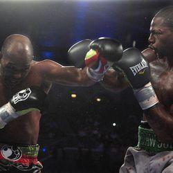 Bernard Hopkins, left, ducks a punch by Chad Dawson in the 10th round of their  light heavyweight boxing match in Atlantic City, N.J., Saturday, April 28, 2012. Dawson won a majority decision.