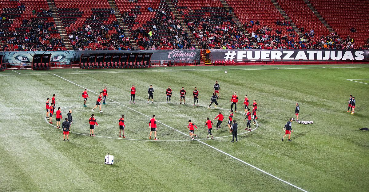 Xolos players practice at Estadio Caliente in front of fans.