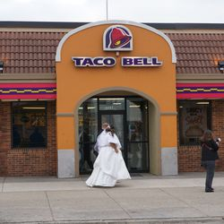 Wedding party heading back to their bus, passing in front of the Taco Bell on Addison Street