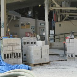 11:14 a.m. Concrete blocks stacked at the main bleacher gate -