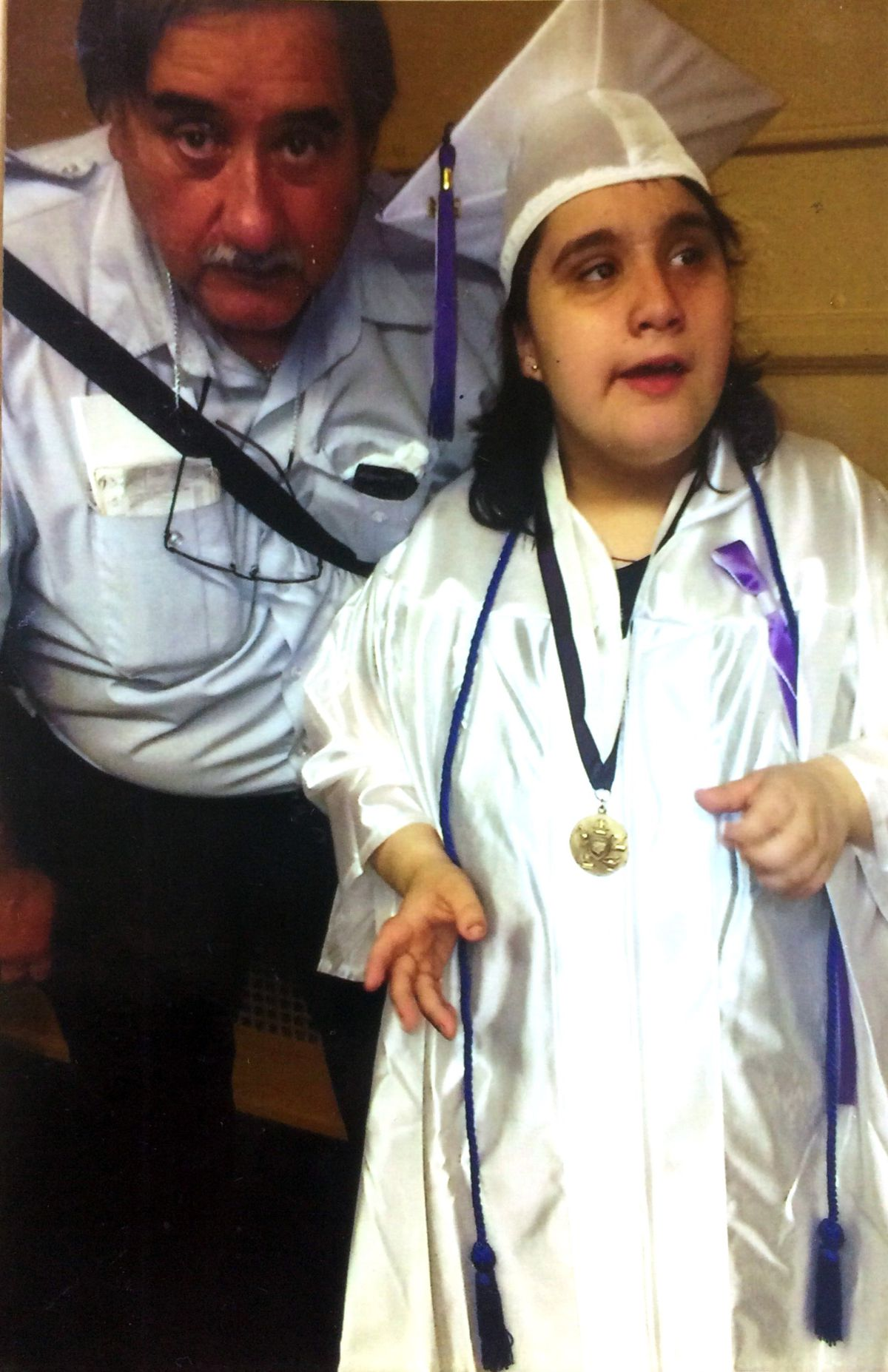 Sylvana and her father, Jerry, at her eighth grade graduation from McPherson