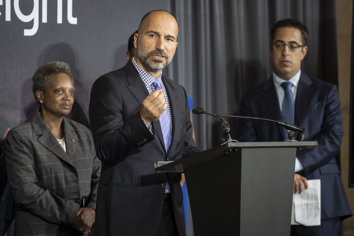 Uber CEO Dara Khosrowshahi, center, with Mayor Lori Lightfoot and Lior Ron, head of Uber Freight, at the company's September 2019 announcement of a lease at the Old Post Office.