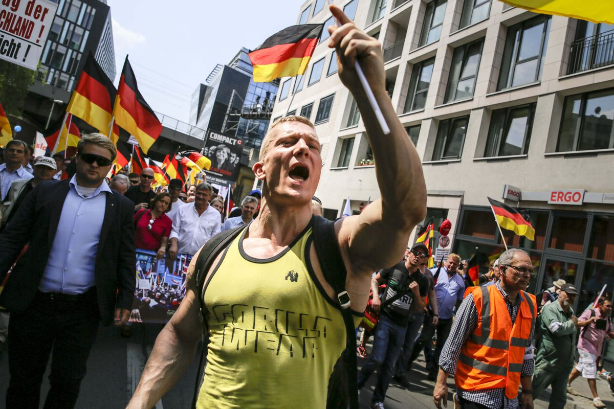 "A protester shouts slogans during the right-wing Alternative for Germany political party demonstration titled ""Future Germany"" on May 27, 2018 in Berlin."