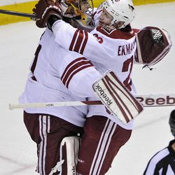 Phoenix Coyotes goalie Mike Smith, left, and Oliver Ekman-Larsson, of Sweden, celebrate after they defeated the against the Minnesota Wild 4-1 in an NHL hockey game on Saturday, April 7, 2012, in St. Paul, Minn.