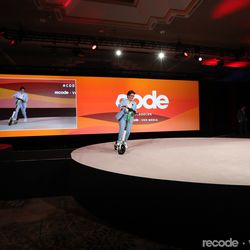 Kara Swisher takes the stage on a scooter to introduce Mary Meeker