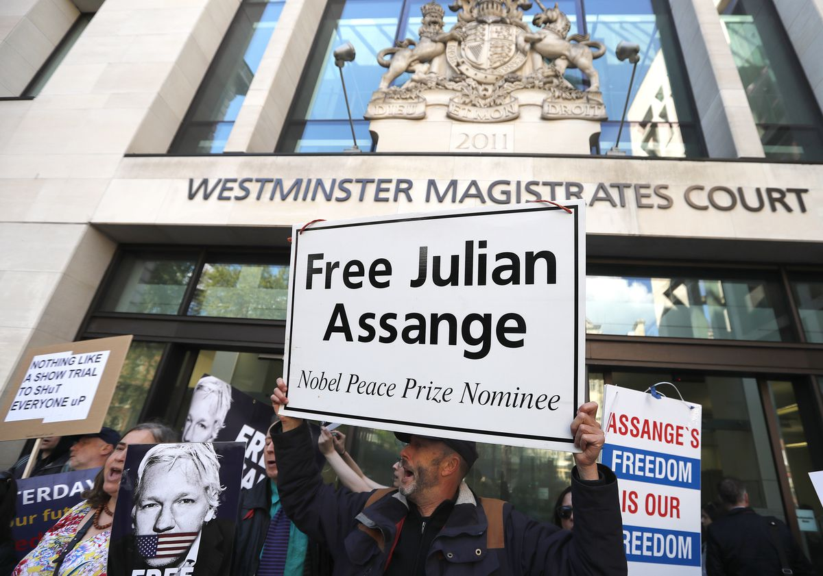 Protestors demonstrate at the entrance of Westminster Magistrates Court in London, Thursday, May 2, 2019, where WikiLeaks founder Julian Assange is expected to appear by video link from prison. Assange is facing a court hearing over a U.S. request to extr