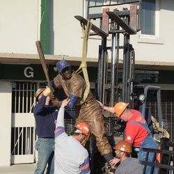 5:17 p.m. Forklift being used to hoist the statue -