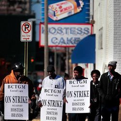 Members of the bakery, confectionery, tobacco, and grain millers union (BCTGM Local 149) gather to strike outside the Hostess bakery on Monroe Monday Nov. 12, 2012, in Memphis, Tenn. The union, which has been on strike since Friday, is trying to prevent new wage and benefit cuts which the company is making nation wide.