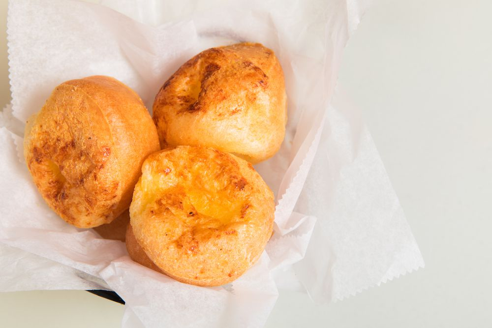 A dish containing popovers.