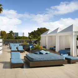 The sun deck features lounge chairs, sunbeds and cabanas. Summer can't come soon enough.
