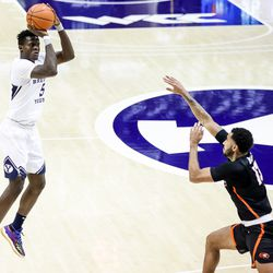 Brigham Young Cougars forward Gideon George (5) shoots over Pacific Tigers forward Jeremiah Bailey (13) at the Marriott Center in Provo on Saturday, Jan. 30, 2021.
