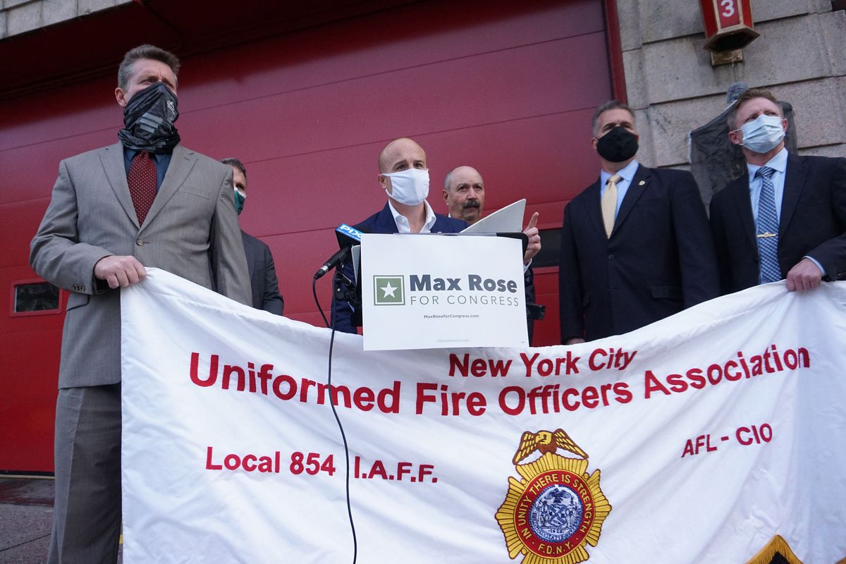 Congressional Rep. Max Rose speaks with with officials from the New York City Uniformed Fire Officers Association, Oct. 20, 2020.
