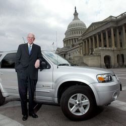 Bob Bennett stands next to his Ford Escape Hybrid, Thursday May 18, 2006, near the Capitol Building in Washington DC.