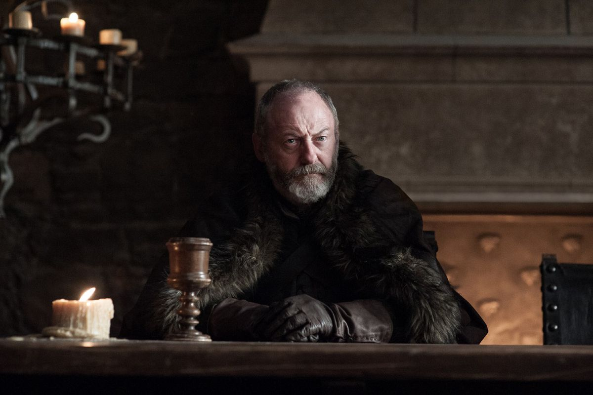 Game of Thrones season 7 photos - Davos sitting at a long table in Winterfell's Great Hall