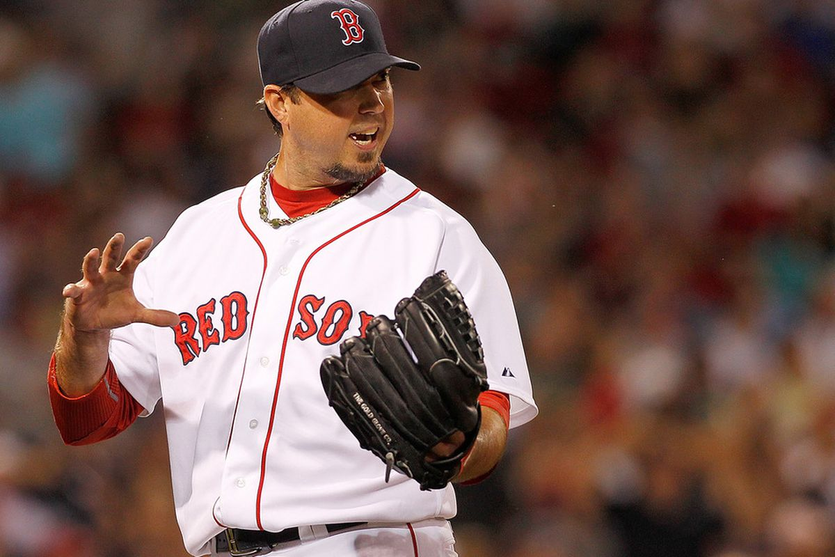 BOSTON, MA - MAY 31: Josh Beckett #19 of the Boston Red Sox reacts in the seventh inning against the Detroit Tigers at Fenway Park May 31, 2012  in Boston, Massachusetts. (Photo by Jim Rogash/Getty Images)