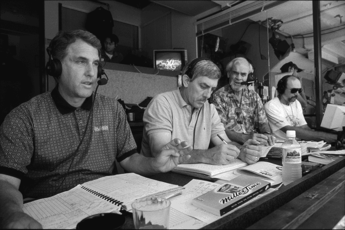 Ken, Ray, and Bill at work, with Ken apparently calling for an intentional walk. Photo is courtesy of Wellstone Books.