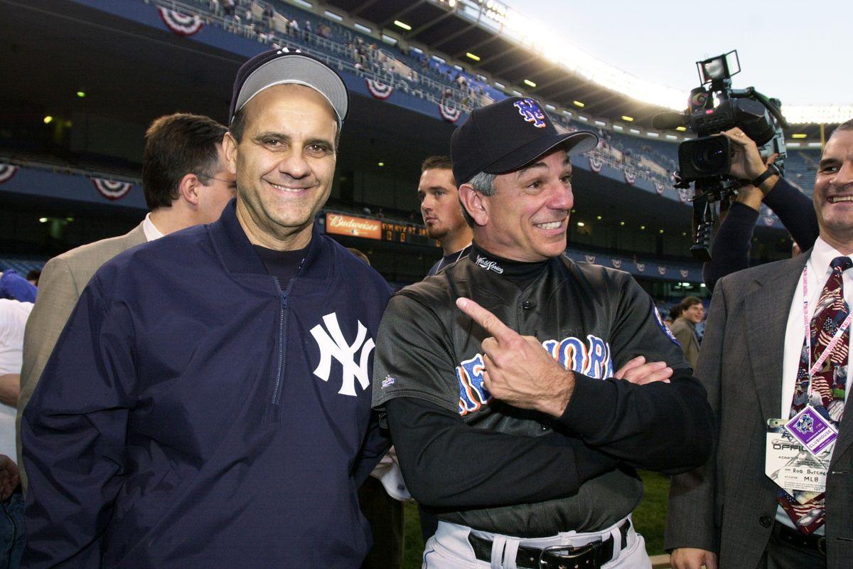 New York Yankees' manager Joe Torre jokes with New York Mets