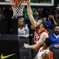 Utah forward David Collette (13), dunks against Oregon during the first half of an NCAA college basketball game Saturday, Dec. 29, 2017, in Eugene, Ore. (AP Photo/Thomas Boyd)