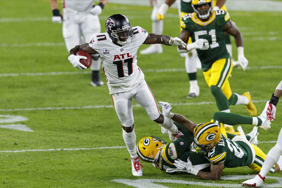 Atlanta Falcons wide receiver Julio Jones is tackled after catching a pass during the second quarter against the Green Bay Packers at Lambeau Field.
