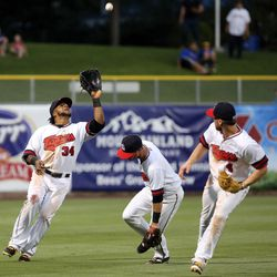 The Salt Lake Bees' Cesar Puello catches a ball during a baseball game against the Reno Aces in a baseball game at Smith's Ballpark in Salt Lake City on Monday, June 26, 2017. The Bees wore Trappers jerseys for '80s throwback night.