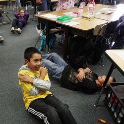 Daniel Berroteran, front, exercises in Nicole Carter's class at Tolman Elementary School in Bountiful, Monday, Nov. 26, 2012.