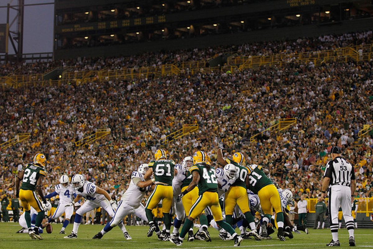 GREEN BAY WI - AUGUST 26: Adam Vinatieri #4 of the Indianapolis Colts kicks a field goal against the Green Bay Packers during a preseason game at Lambeau Field on August 26 2010 in Green Bay Wisconsin. (Photo by Jonathan Daniel/Getty Images)