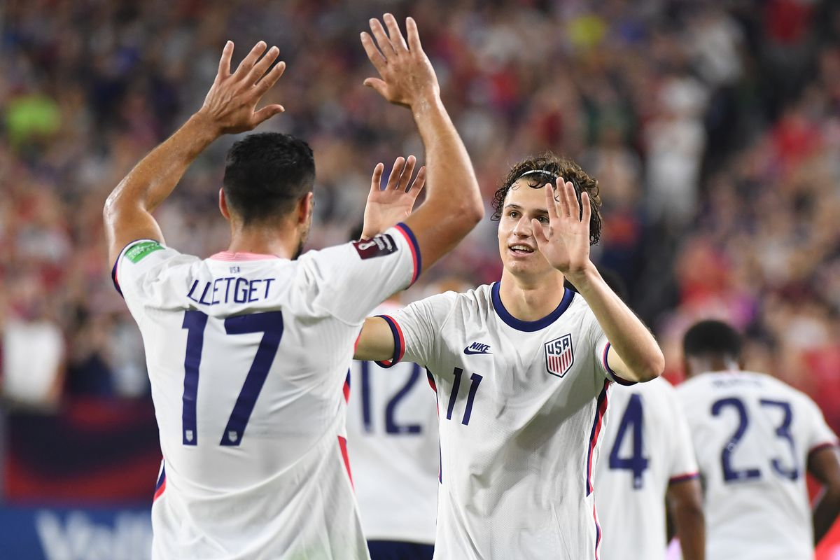 United States midfielder Brenden Aaronson (11) celebrates with United States midfielder Sebastian Lletget (17) after scoring a goal in the second half against Canada during a CONCACAF FIFA World Cup Qualifier soccer match at Nissan Stadium.