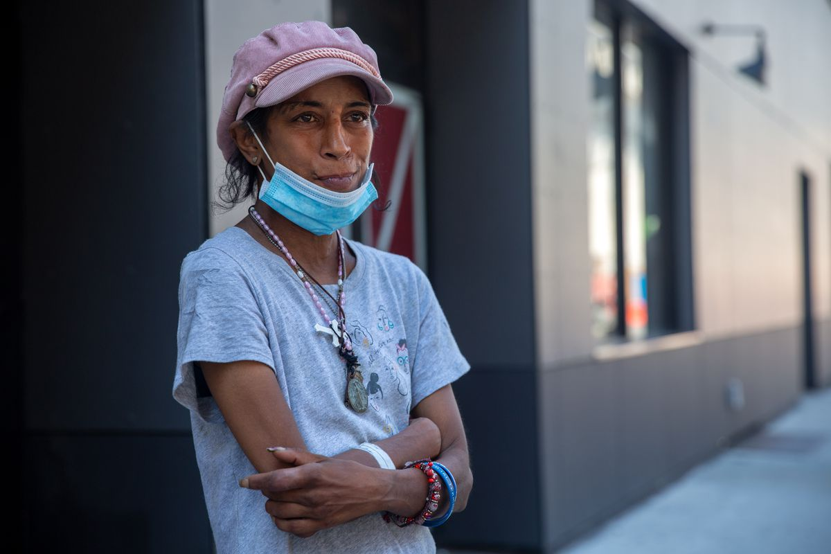 Charmain Hamid, 45, says water is hard to come by since the pandemic and she mostly relies on handouts and a Starbucks near Penn Station, Aug. 3, 2020.