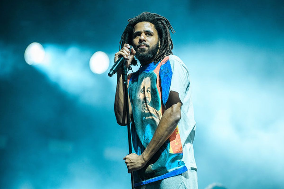 J Cole performs on stage