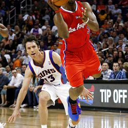 Los Angeles Clippers' Chris Paul, right, shoots past Phoenix Suns' Steve Nash (13) during the first half of an NBA basketball game, Thursday, April 19, 2012, in Phoenix. (AP Photo/Matt York)