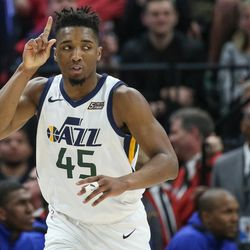 Utah Jazz guard Donovan Mitchell (45) celebrates after sinking a three during the game against the Golden State Warriors at Vivint Arena in Salt Lake City on Tuesday, April 10, 2018.