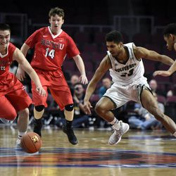 Seattle's Zackary Moore (30), Jack Shaughnessy (14) and Emmanuel Chibuogwu (13) and Utah Valley's Kenneth Ogbe (25) chase the ball during the second half of an NCAA college basketball game in the first round of the Western Athletic Conference tournament Thursday, March 9, 2017, in Las Vegas.