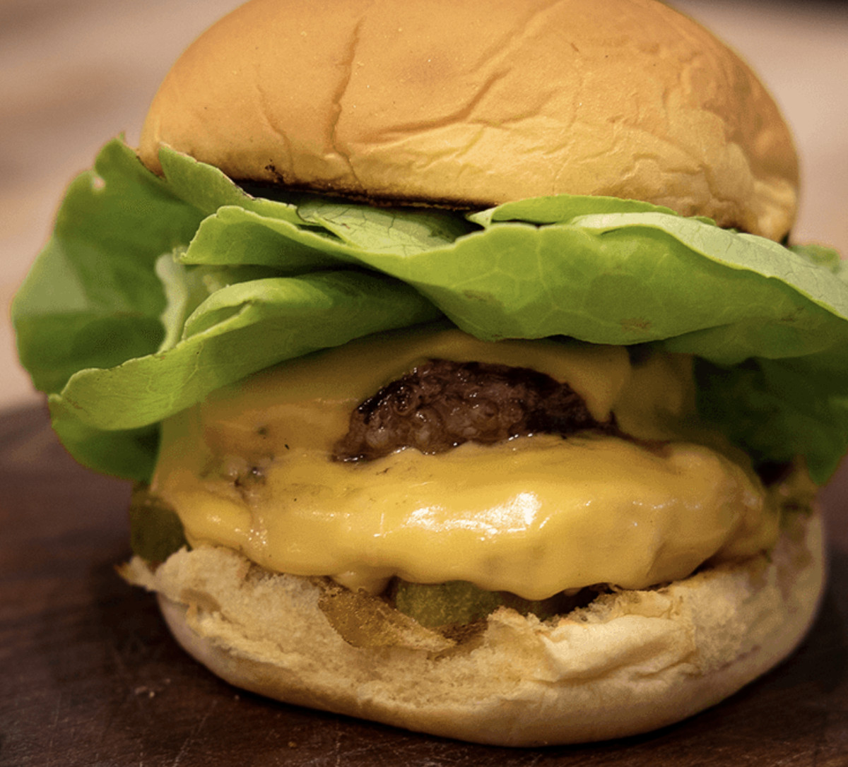 A photo of the double-burger  from Folsom Foods consisting of a burger topped with yellow cheese and lettuce