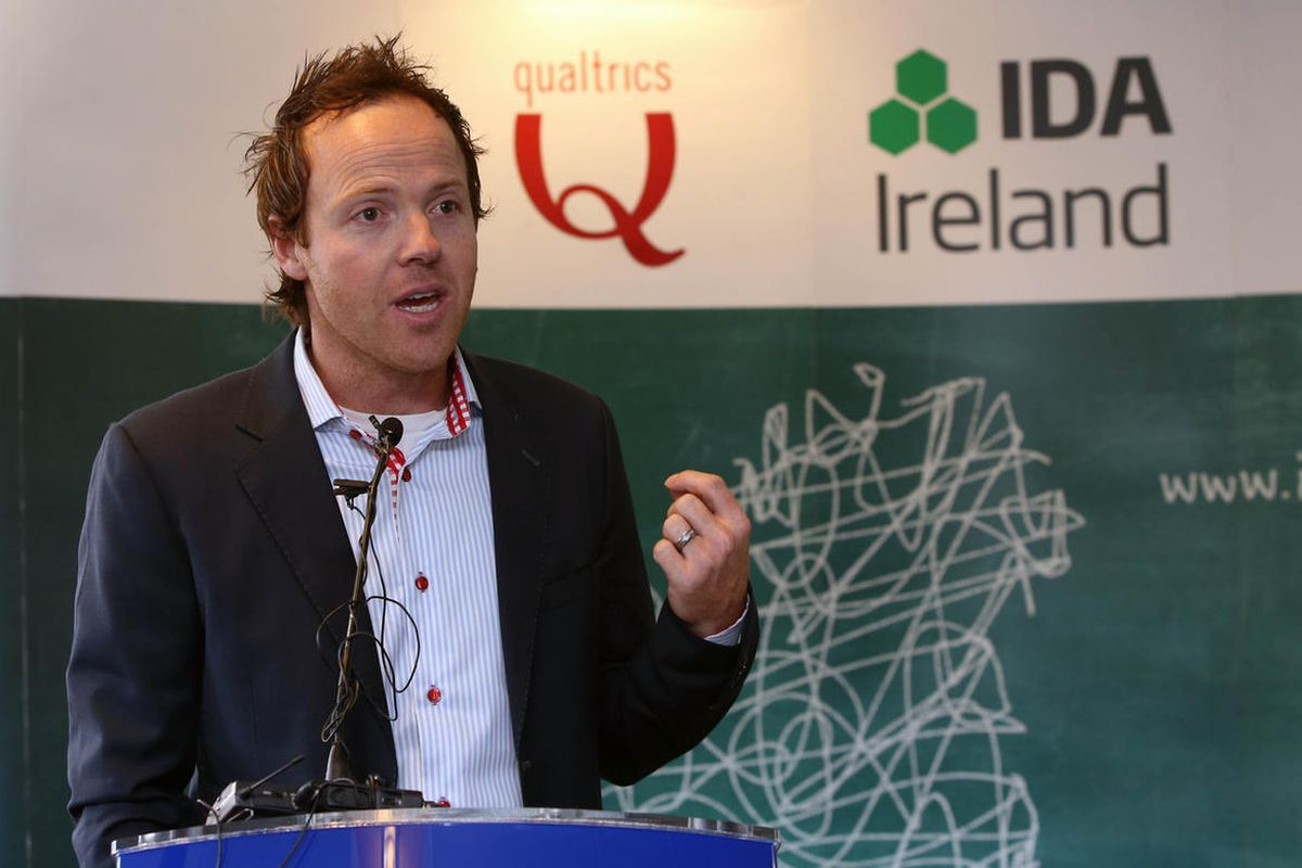Qualtrics CEO Ryan Smith speaks during the company's official opening of their European headquarters on Friday, Sept. 27, 2013.