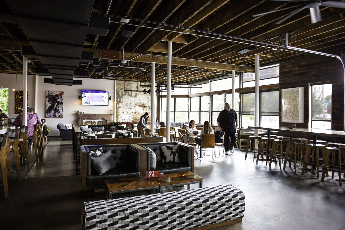 A photo of the interior of Avanti Food & Beverage showing lounge and bar seating