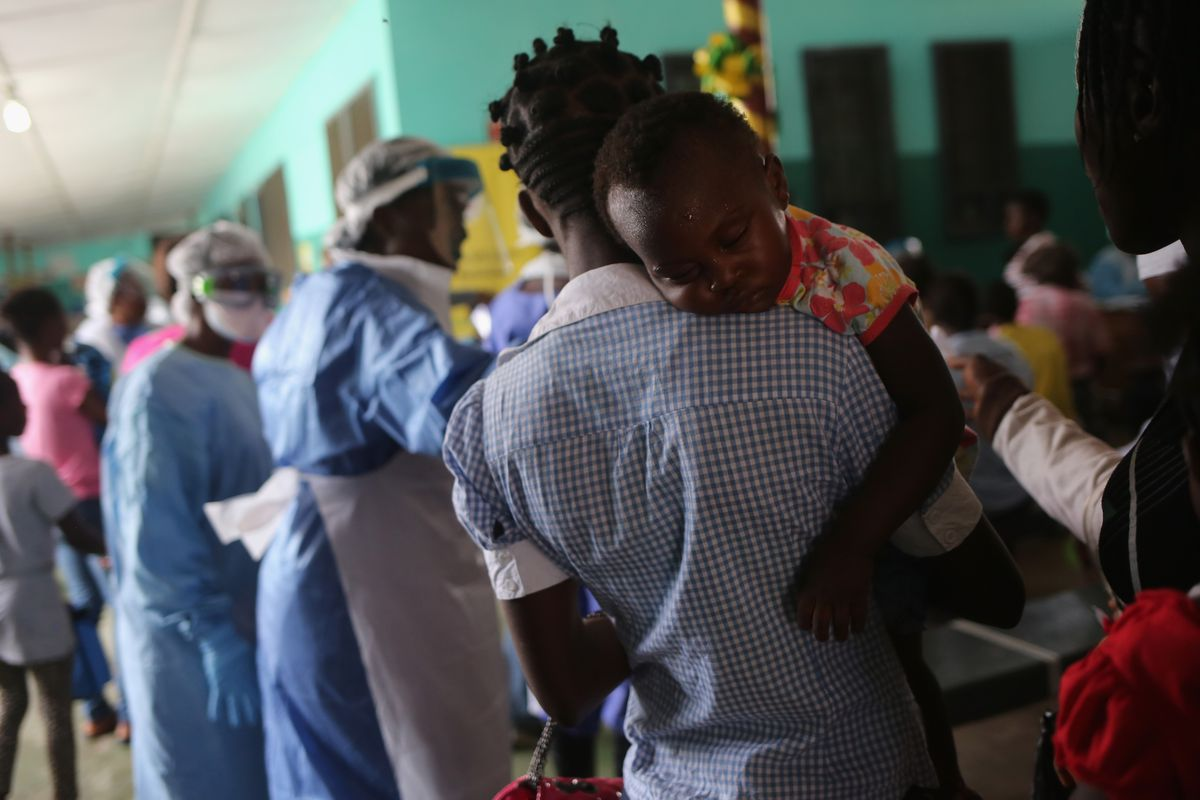 People await treatment in the outpatient lounge of Liberia's Redemption Hospital, where a new case of Ebola was just discovered.