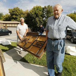 Latter-day Saint volunteers Bruce Brockbank and Sigfried Schneider and others help Catholics set up for the Carmelite Fair at the monastery in Holladay Tuesday, Sept. 16, 2014.