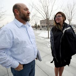 Lee Garcia and his stepdaughter, Kathleen Janis, talk outside the federal courthouse in Salt Lake City on Wednesday, Feb. 1, 2017. Kathleen, a ninth-grade student at Central Davis Junior High, is suing the Davis School District because she isn't allowed to participate in her school's wrestling program.