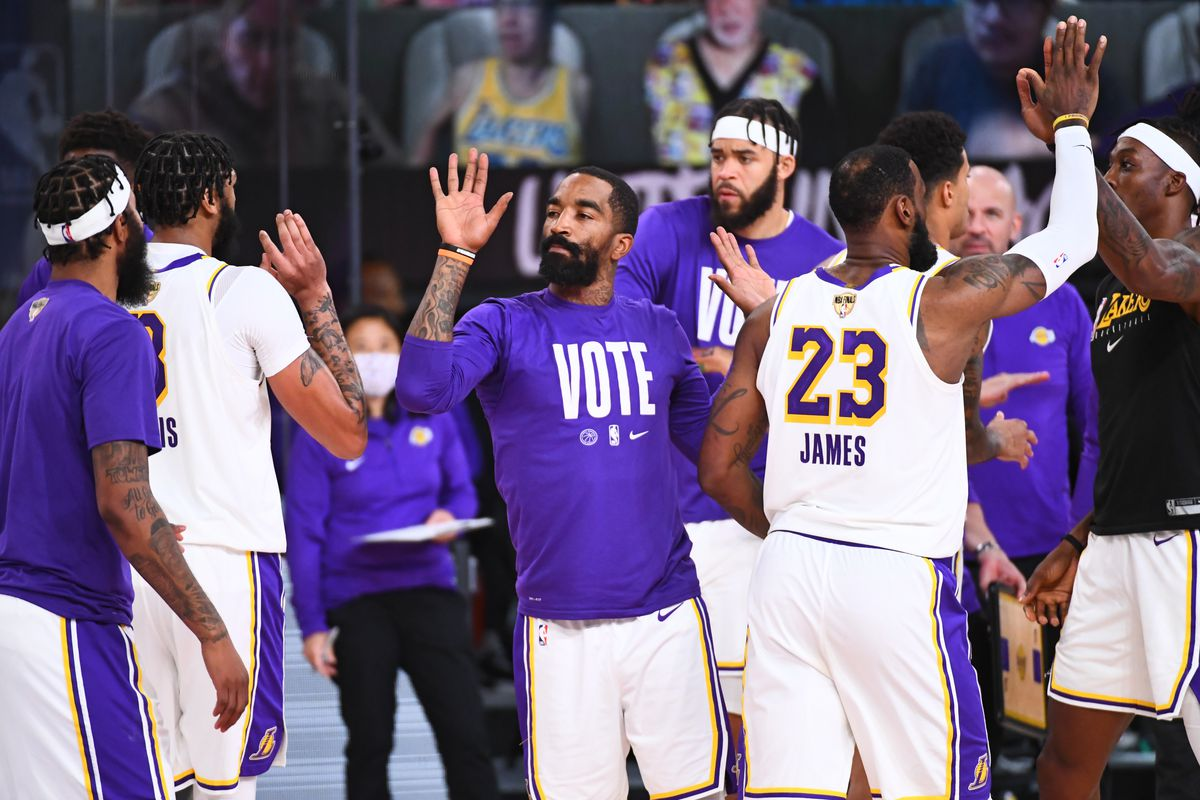 JR Smith of the Los Angeles Lakers high-fives his teammates during Game Six of the NBA Finals on October 11, 2020 at the AdventHealth Arena at ESPN Wide World Of Sports Complex in Orlando, Florida.