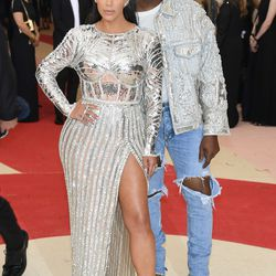 Kim Kardashian wears Balmain, while Kanye West wears Givenchy, Fear of God jeans, and accessorizes with blue contact lenses.