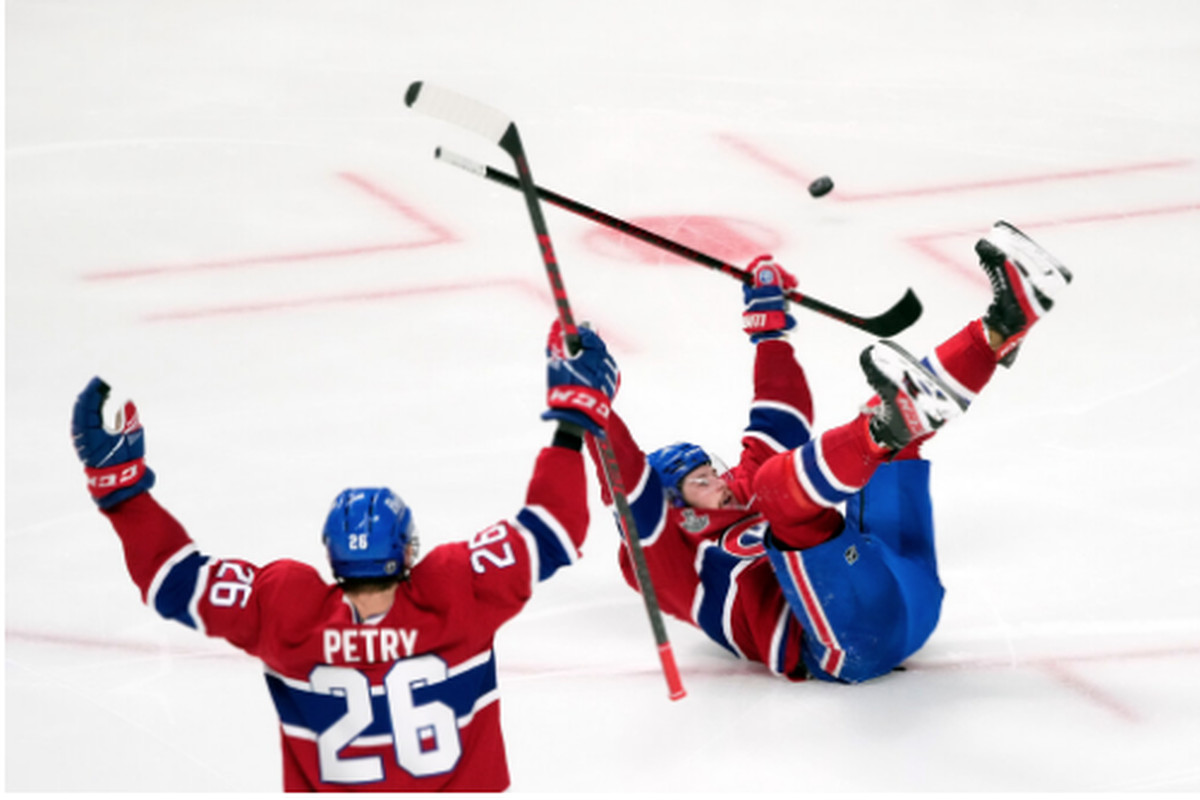 The Canadiens' Josh Anderson (lying on the ice) celebrates his game-winning goal in overtime Monday against the Lightning in Montreal.