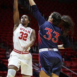 Utah Utes forward Tanaeya Boclair (32) shoots over Saint Mary's center Claire Ferguson (33) as Utah hosts Saint Mary's at the Huntsman Center in Salt Lake on Saturday, Dec. 2, 2017.