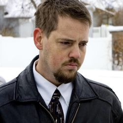 Josh Powell, husband of the missing woman Susan Powell, listens at a press conference at West View Park in West Valley City, Utah, as Kirk Graves, brother-in-law of Susan, speaks to the media on Saturday, Dec. 12, 2009.
